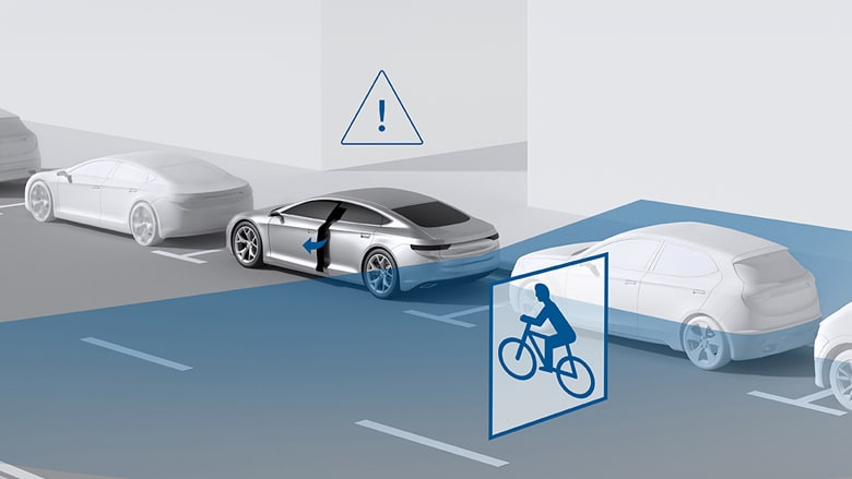 Cyclist approaching parking cars